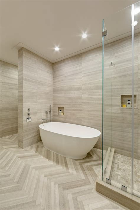 modern master bathrooms high ceiling herringbone tile floors by artistic tile on