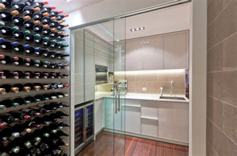 sliding door design for kitchen wine cellar and a small kitchen connected visually using