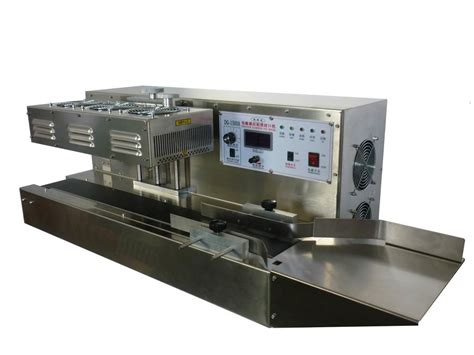 working principle of induction sealing machine automatic wind cooling electro magnetic induction sealing machine