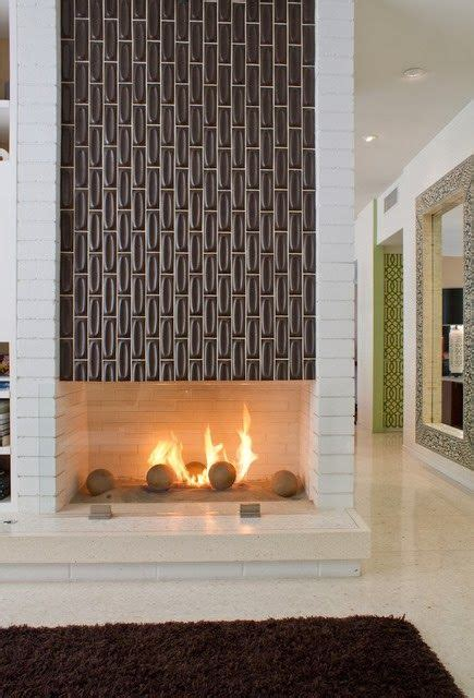 mid century modern fireplaces a mid century modern two sided fireplace featuring tile