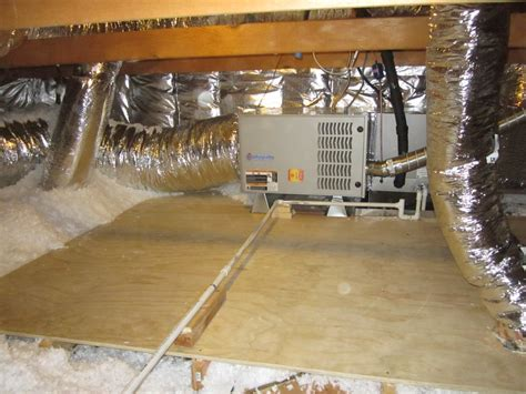 view of a furnace moved to the attic storage platform