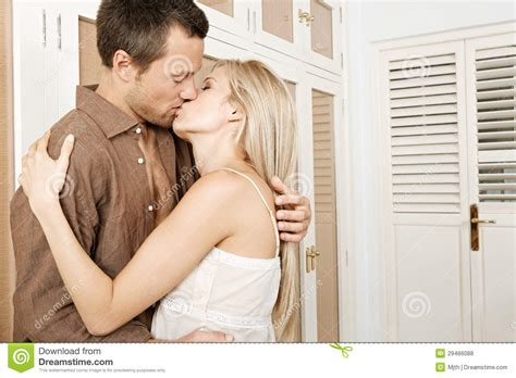 kissing in bedroom couple hugging and kissing in bedroom stock photo image