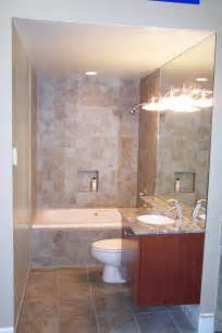 small space bathroom big wall mirror with wall lamp stone tile decorating