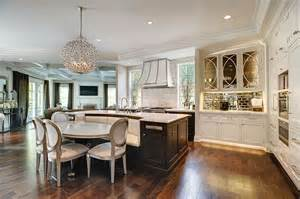 lovely Designing A Kitchen Island With Seating #1: kitchen-with-white-flat-panel-cabinets-and-large-island-with-built-in-seating-bench.jpg