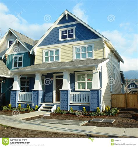 Porch House Plans Home Yellow And Blue House For Sale Stock Photo Image