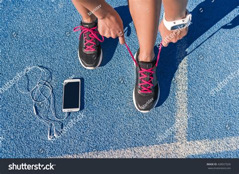 tie running shoes properly runner tying running shoes laces stock photo