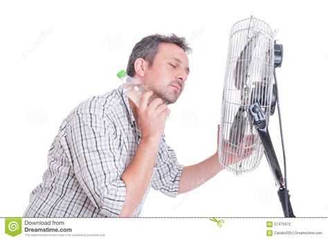 what is the best fan that blows cold air man down in front of blowing fan stock photo