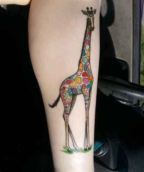 this is my rainbow giraffe tattoo done by the fantastic