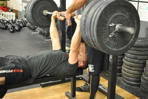 bench press how low high reps vs low reps the barbell battalion
