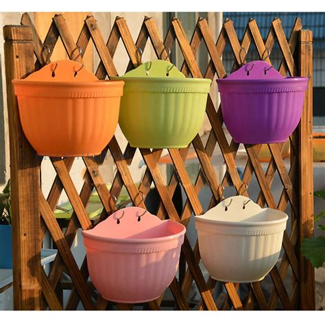 Plastic Half Wall Planters by Colorful Plastic Flower Pots Wall Hanging Garden Half