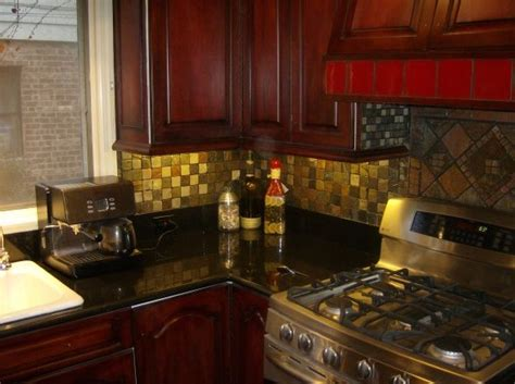 mahogany kitchen cabinets with granite countertops kitchens with black countertops red walls red