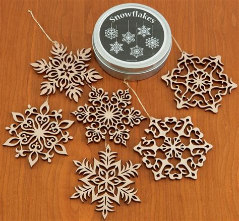 Wooden Ornament set of six wooden snowflake ornaments in gift tin