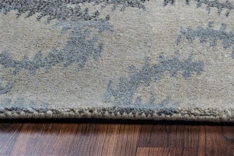 volare floral ikat wool area rug in gray blue navy 5 x 8