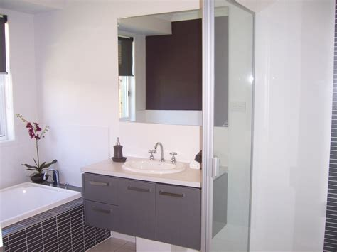 how to design a bathroom how to make a small bathroom look bigger the plumbette