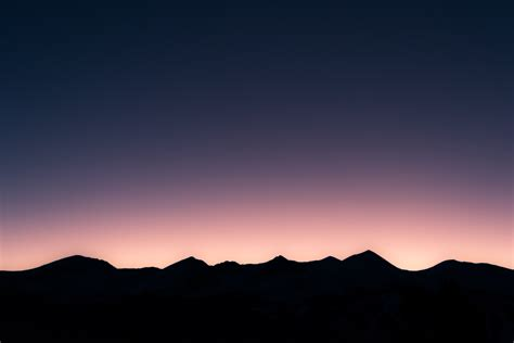 Minimalist Computer by Picalls Com Silhouette Of Mountains At Sunset By Unsplash