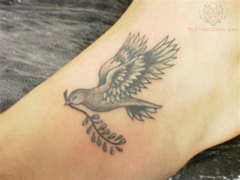 small peace tattoo dove carrying olive branch meaning the best dove 2017
