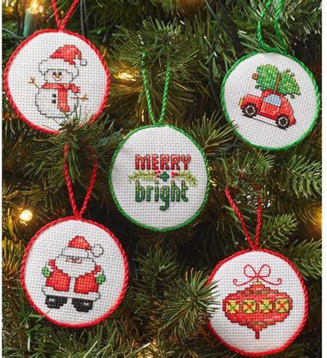 bucilla santa at the globe norman rockwell cross stitch