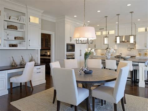 transitional dining rooms dining room with crown molding pendant light in