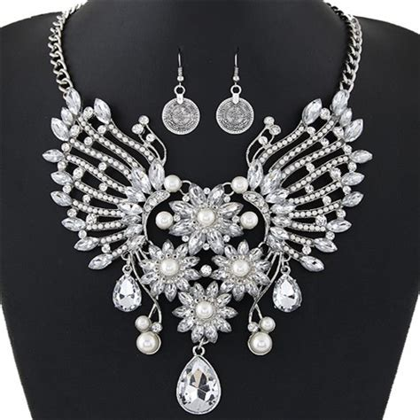 Hollow Wings In The Earrings dazzling flowers and hollow wings combo design