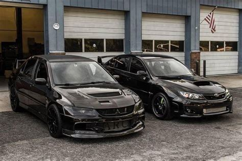 subaru evo black blacked out mitshubishi lancer evo and subaru impreza wrx