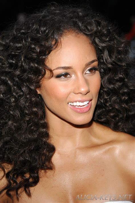 black hair tight curls edgy wedding hairstyle for hair with natural curls