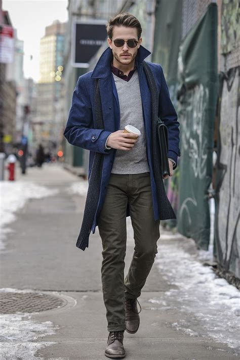 fashion for 20 year old men picture of a blue coat olive green pants a grey sweater