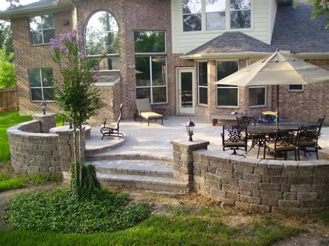 Raised paver patio with bench seating and lighting.   Yelp