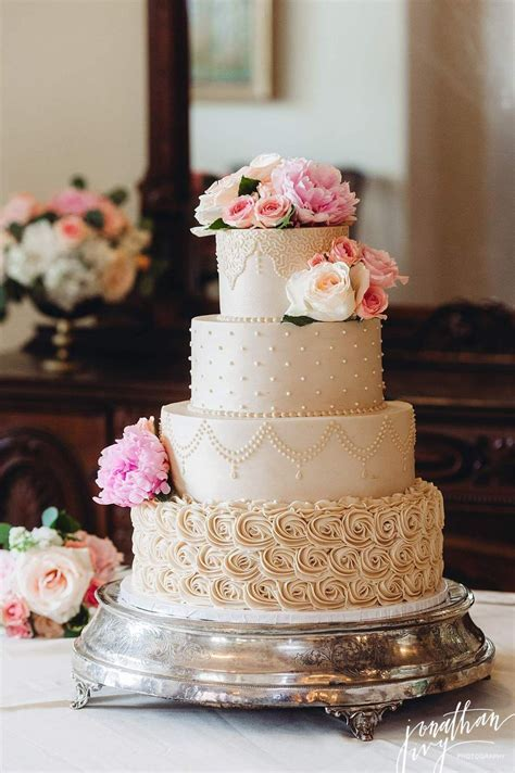 Beautiful beige 4 tier buttercream wedding cake #