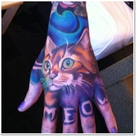 cat tattoo in hand meow 25 amazing cat tattoos