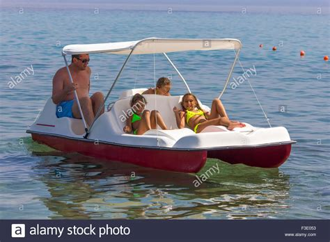 pedal boat whistler family on the pedal boat stock photo royalty free image