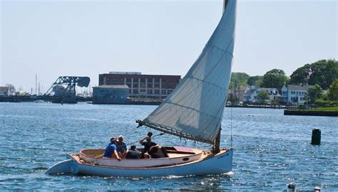 mystic ct boat tours mystic river cat boat sailor going by shot from