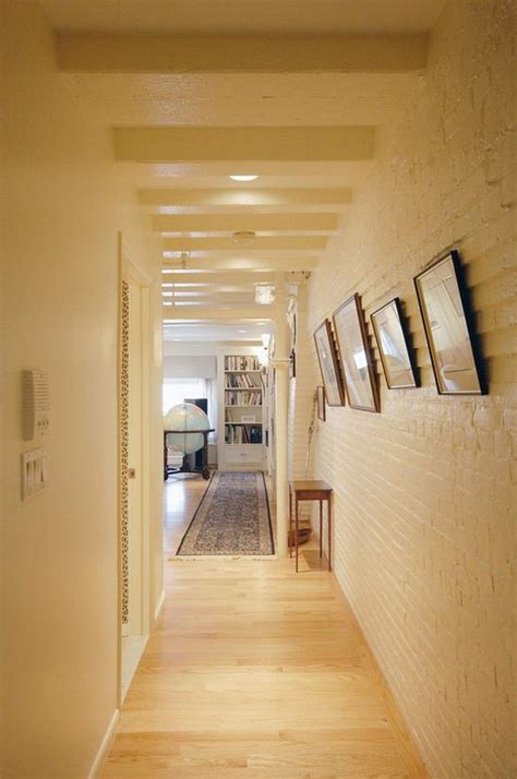 hall painting incorporating exposed bricks in stylish designs around the