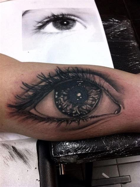 tattooing eyes 61 mind blowing eye tattoos on arm