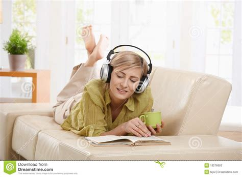 reading couch woman reading on couch stock photos image 16276693