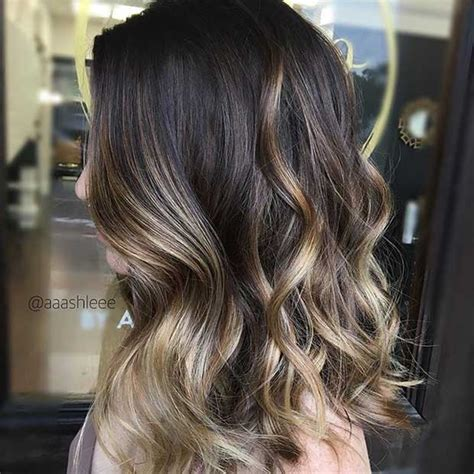 how to put blonde highlights in black hair 27 stunning blonde highlights for dark hair stayglam