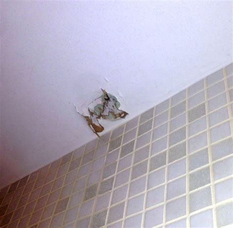 can i put a shower curtain in the washing machine bathroom how can i patch the ceiling and rehang a shower