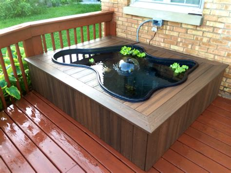 deck pond using 2x4 s as a structure deck boards and a plastic pond liner ponds and