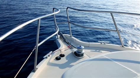 bow clip boat boating in blue ocean sea view from boat bow deck stock