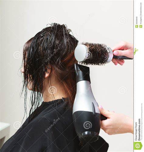 Hair Dressers In by In Hairdressing Salon Hairstylist With Dryer Drying Hair