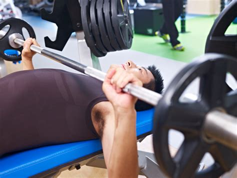 tips to bench more bench press secrets 7 tips to help you lift more