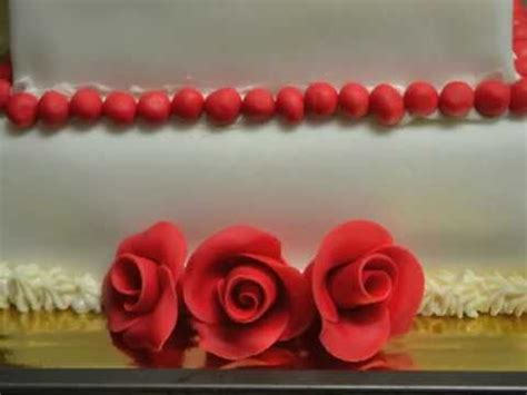 How To Decorate A Tiered Cake by How To Make And Decorate A Three Tiered Cake Using Fondant