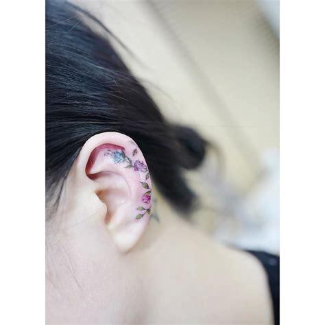 rose ear tattoo on ear by tattooist banul tats tequila