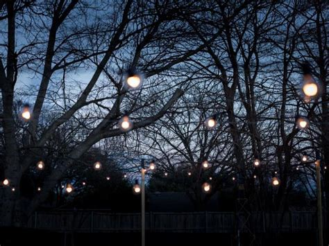 how to hang string lights how to hang outdoor string lights from diy posts hgtv