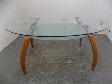 a chromed metal and glass oval dining table designed by modern oval glass dining table office conference table
