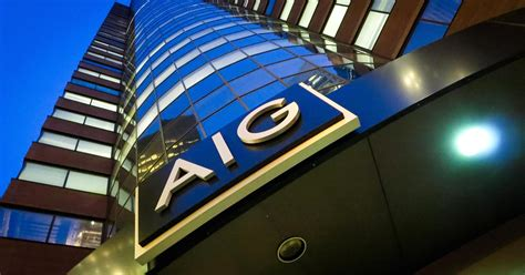 aig reports quarterly earnings