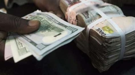currency converter naira a toast to n700 to a dollar by year end by uddin ifeanyi