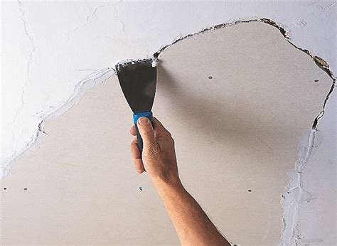 Filling Holes In Ceiling Plasterboard by How To Repair A Ceiling Ideas Advice Diy At B Q