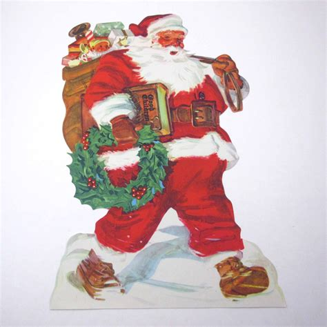 vintage christmas die cut lithograph of jolly santa claus with