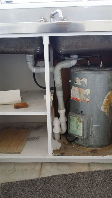 under bench hot water systems under bench hot water cylinder struggles for space hot