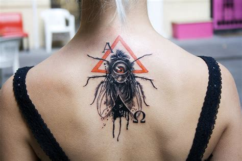 fly tattoos fly god by tikos on deviantart